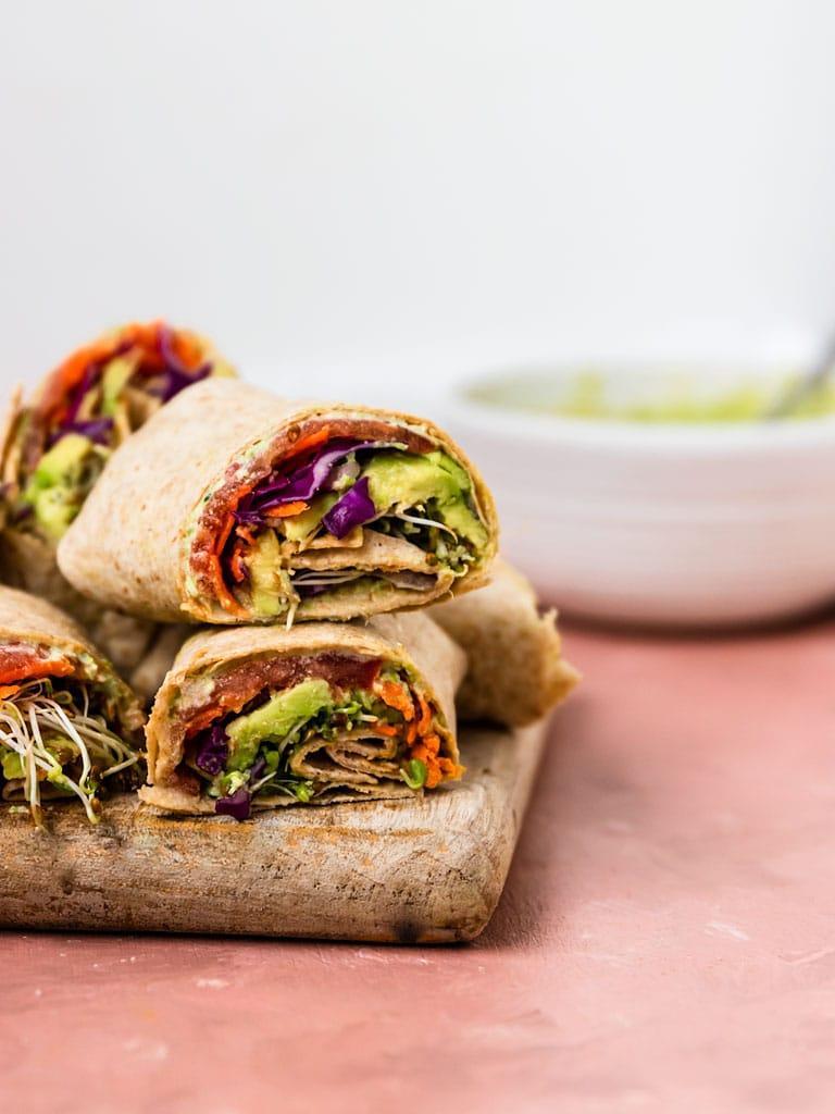 edamame hummus veggie wraps stacked on top of eachother