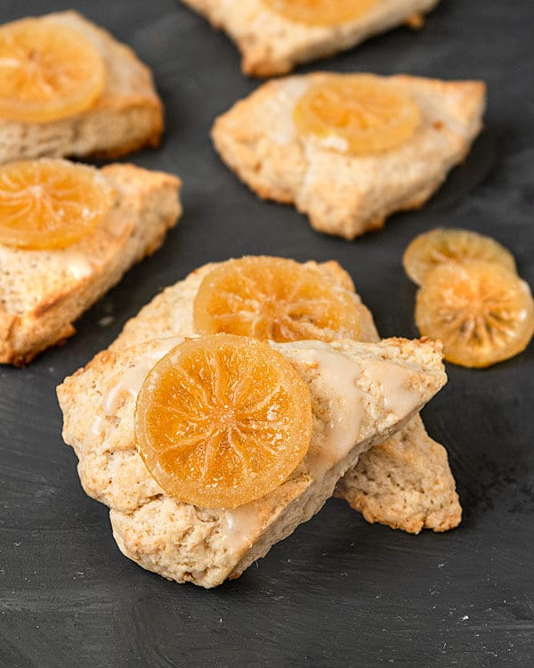 Vegan Lemon Scones topped with lemon glaze and candied lemon slices coated in sugar