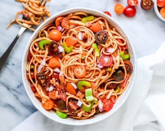 Vegan summer pasta salad with tomatoes, onions, and celery