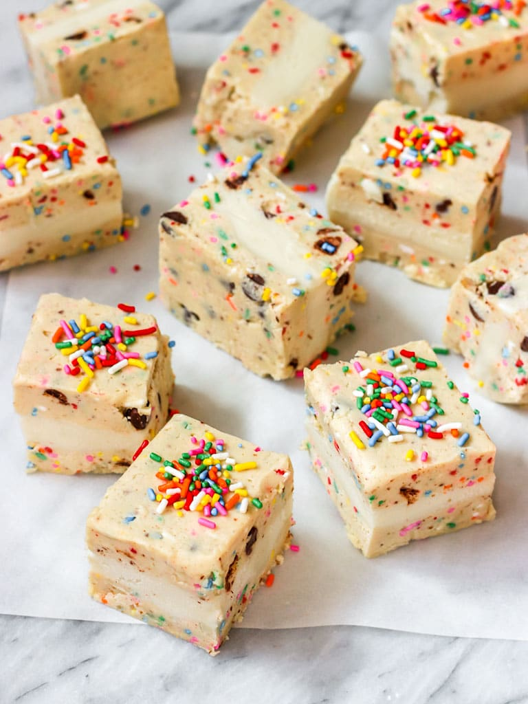 cookie dough ice cream sandwiches with rainbow sprinkles on too