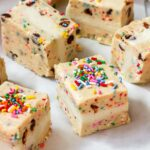 cookie dough ice cream sandwiches with rainbow sprinkles on top