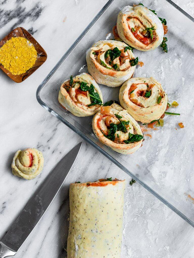 Vegan Pizza Buns being sliced