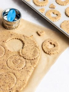 Vegan Linzer cookies being rolled out and cut