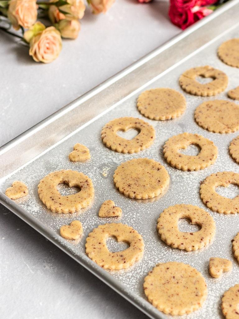 heart shaped linzer cookie dough on baking sheet pre-bake