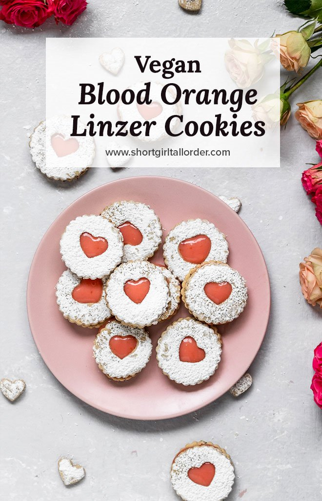 heart shaped linzer sugar cookies filled with blood orange curd