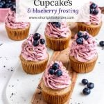 Vegan earl grey cupcakes topped with blueberry and lemon frosting and fresh blueberries on top
