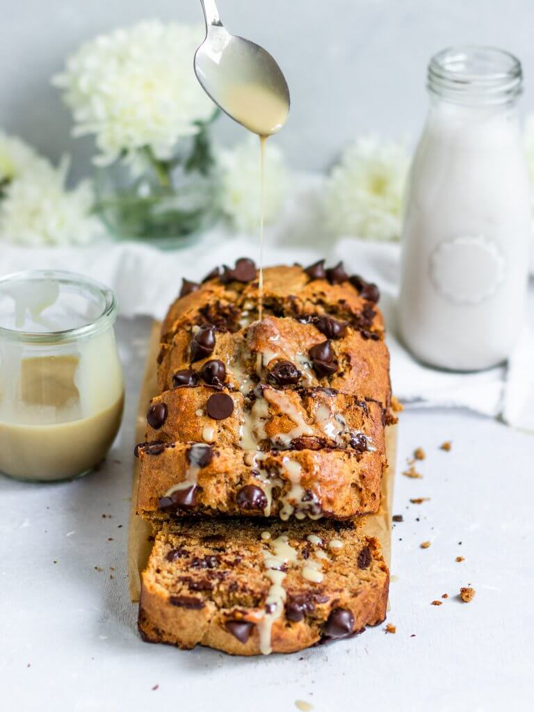 Vegan Tahini Banana Bread with chocolate chips sliced and drizzled with extra tahini