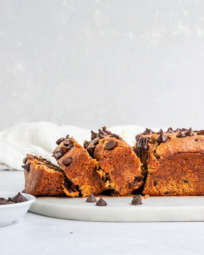 Vegan Tahini Banana Bread filed with chocolate chips and sliced