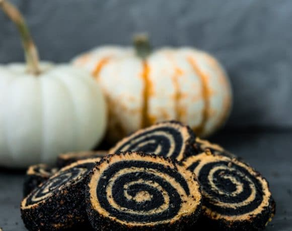 Vegan Charcoal and Pumpkin Shortbread Pinwheel cookies with pumpkins