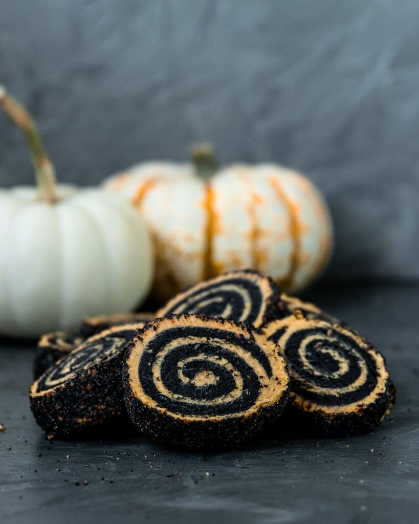 Vegan Charcoal and Pumpkin Shortbread Pinwheel cookies with pumpkins