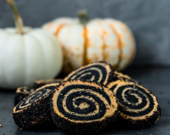 Vegan Pumpkin and Charcoal Pinwheel Cookies with a layer of black and orange sprinkles