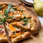 Vegan Pear Pizza with with a creamy garlic sauce , pears, and butternut squash