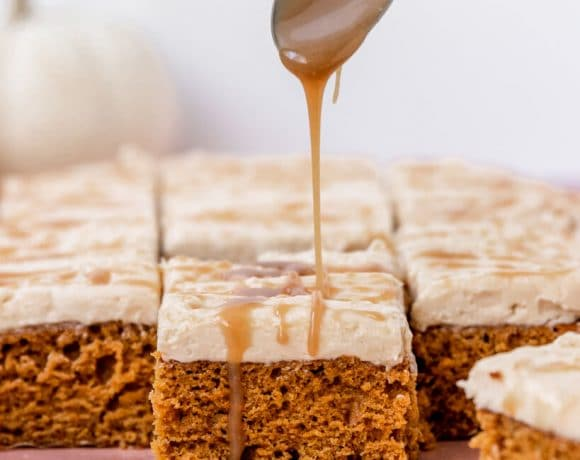 Vegan Pumpkin cake with salted caramel Frosting getting a drizzle of salted caramel on top