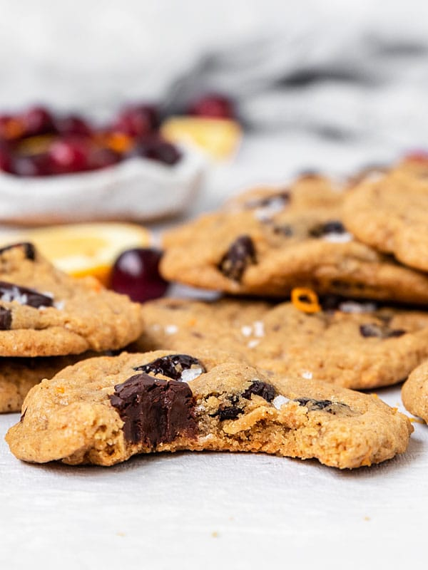 A cranberry orange chocolate chip cookie with a bite taken out