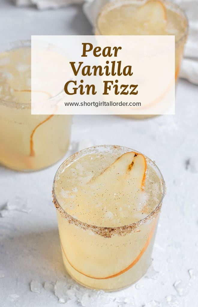 pear vanilla gin fizz cocktail in a cup with pear slice and vanilla sugar rim