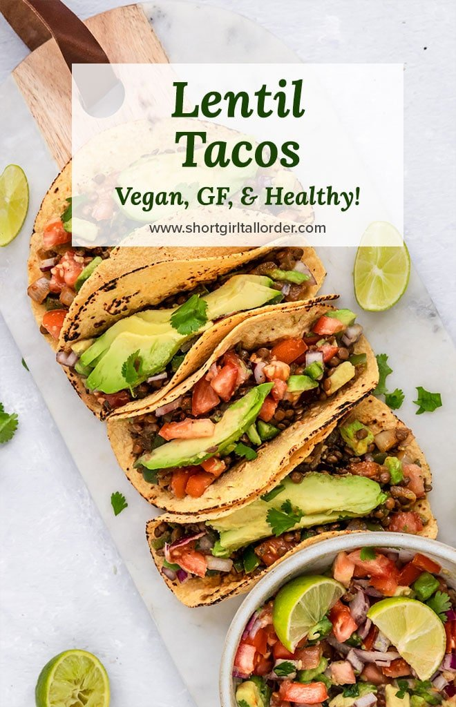 vegan lentil tacos with avocado pico de gallo and lime on a serving board