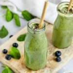 two green breakfast smoothies with spinach, blueberry, banana, hemp seeds
