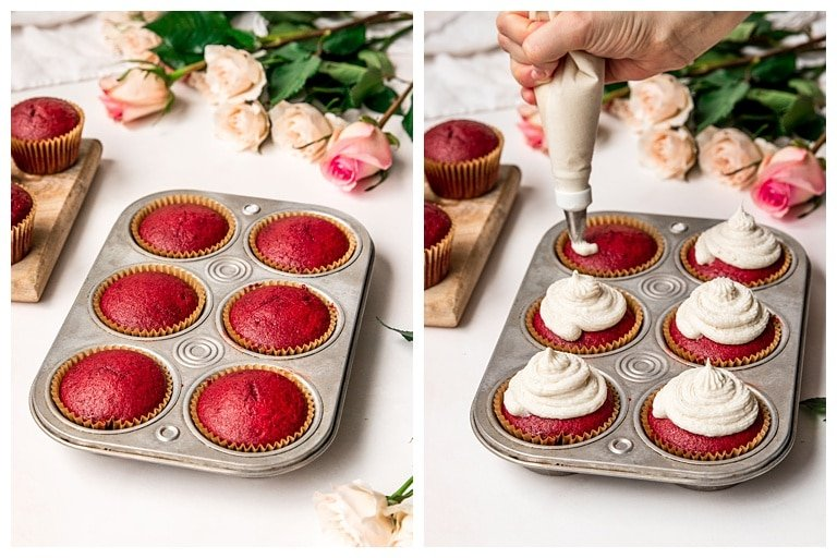 baked red velvet cupcakes in muffin tin being frosted