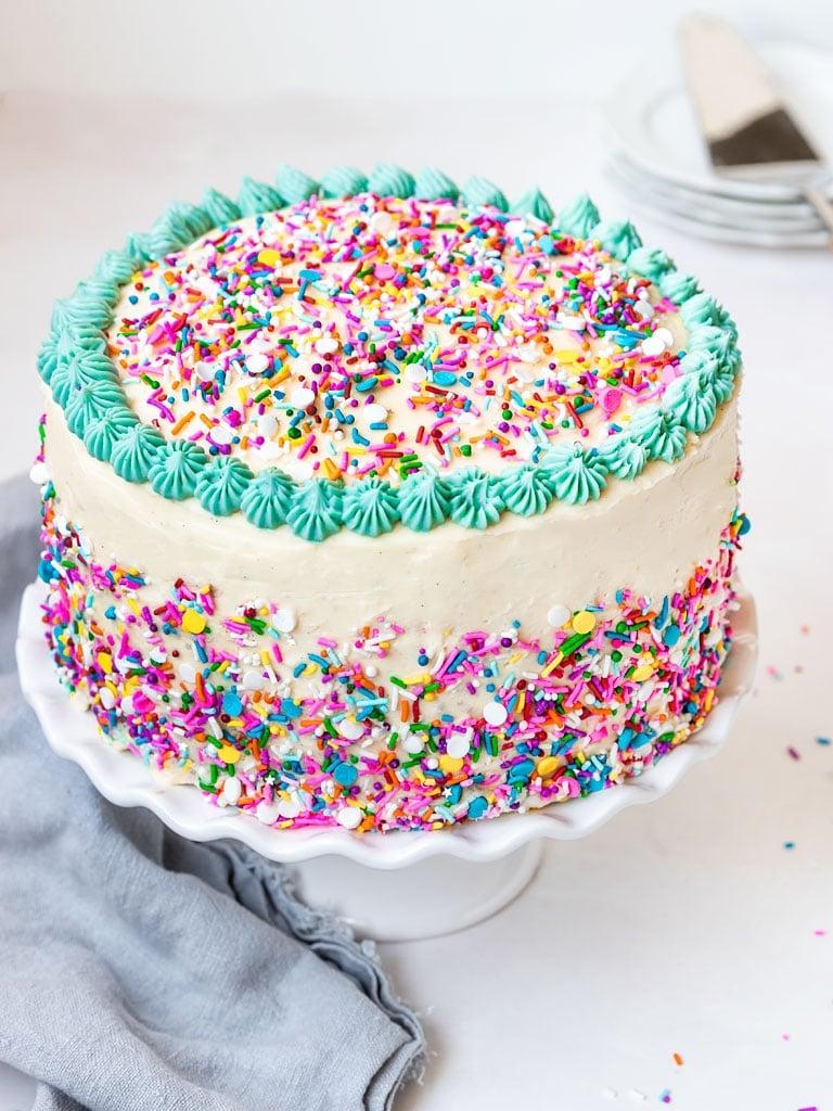 funfetti sprinkle cake on a cake stand