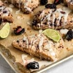 blackberry lime scones with lime glaze on a baking tray