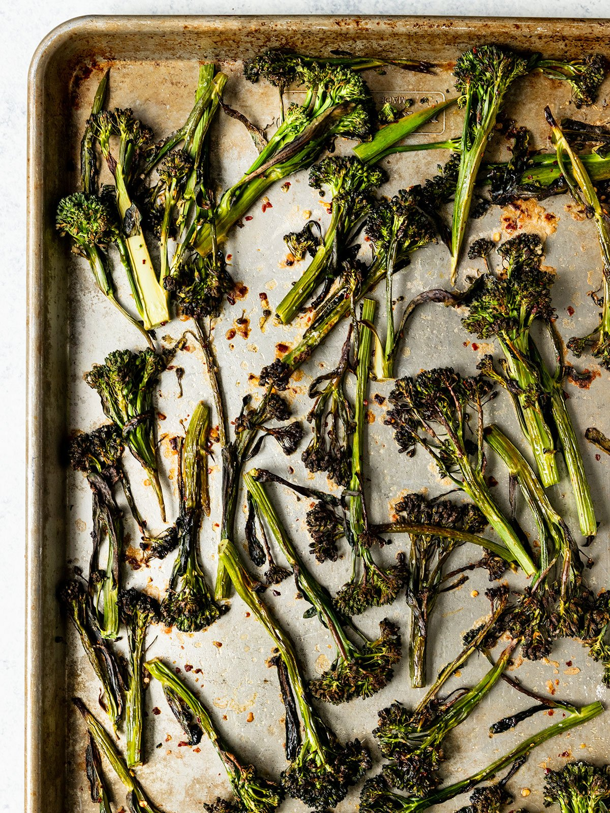 tray topped with roasted broccolini stems