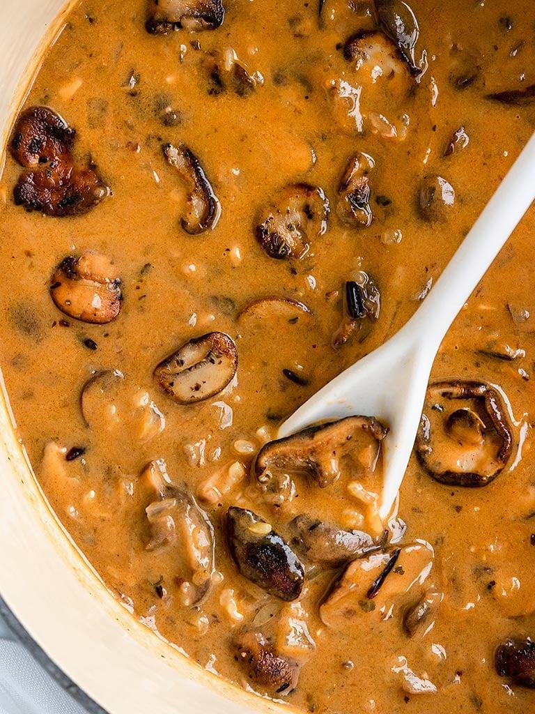 creamy mushroom wild rice soup in a soup pot