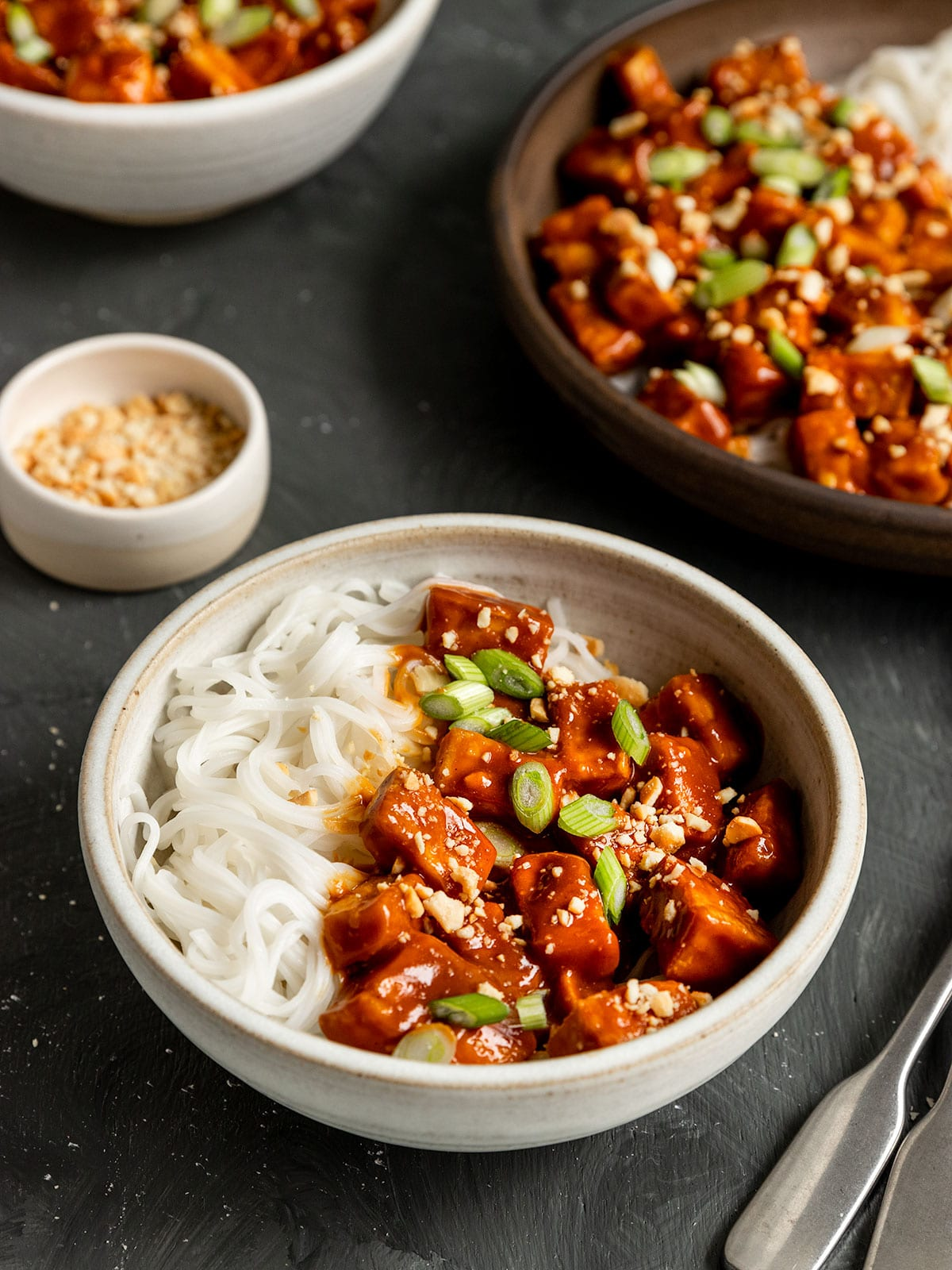 bowl with tofu and spicy peanut sauce