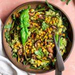 quinoa pesto bowl with corn, asparagus, mushroom, and fresh basil