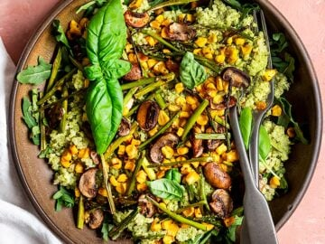 quinoa pesto bowl with corn, asparagus, mushroom, and fresh basil