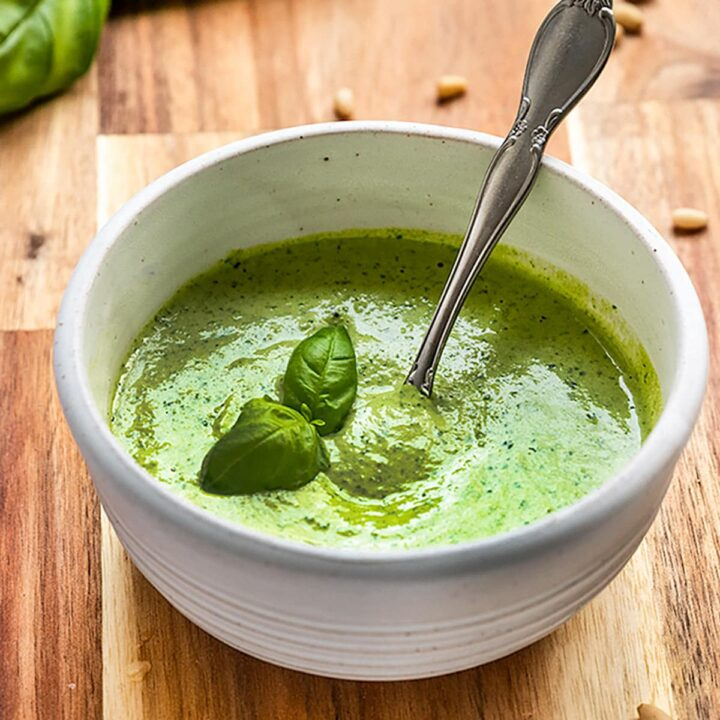 vegan basil pesto in a bowl with basil on top
