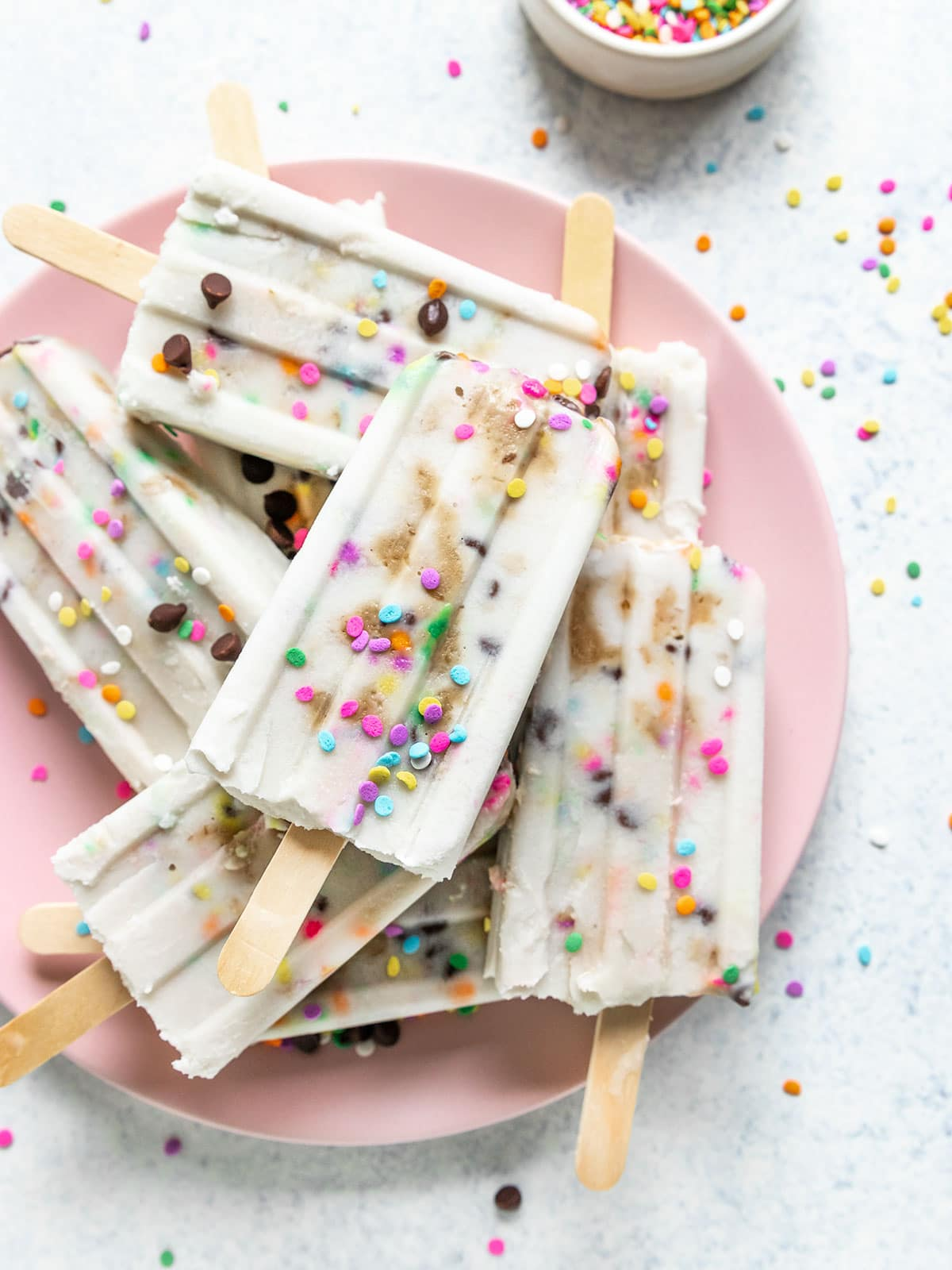 popsicles filled with cookie dough, chocolate chips, and rainbow sprinkles
