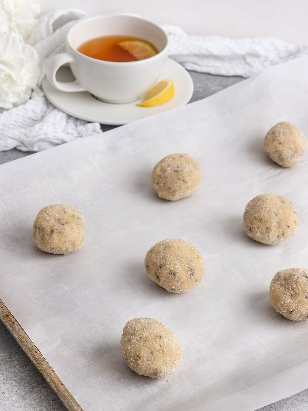 earl grey cookie dough balls on a baking sheet