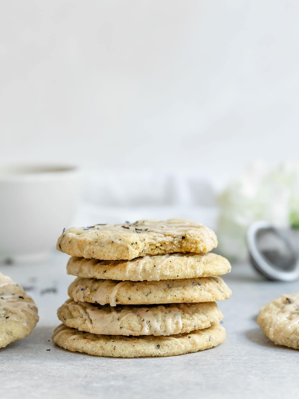 a stack of 5 earl grey sugar cookies with a bite taken out of the top cookie