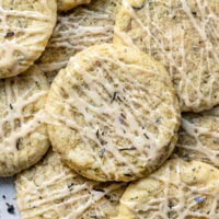 a pile of earl grey sugar cookies with vanilla glaze and earl grey tea leaves dusted on top