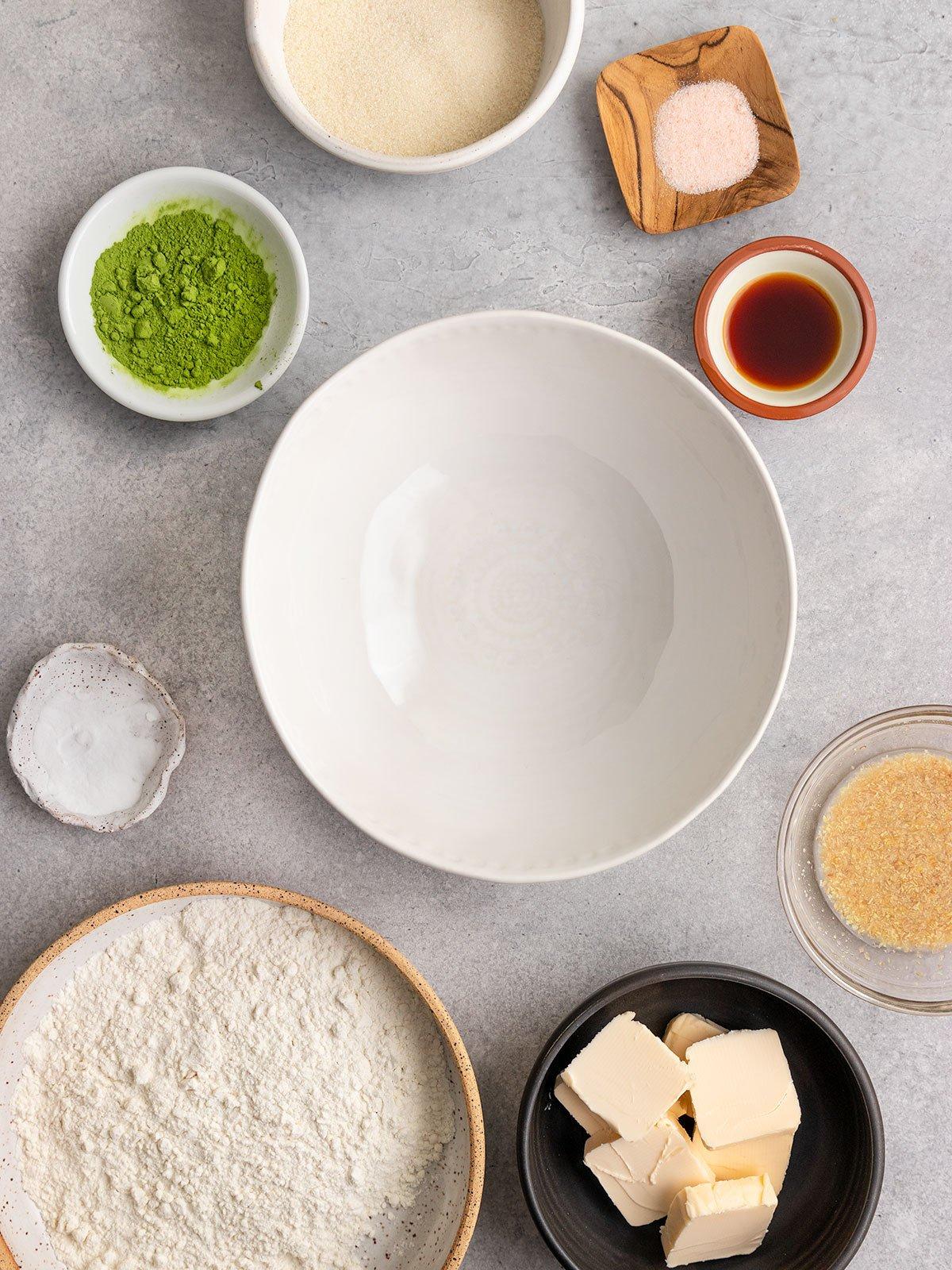 matcha cookie ingredients like flour, vegan butter, sugar, matcha, vanilla, baking powder, flax egg, salt