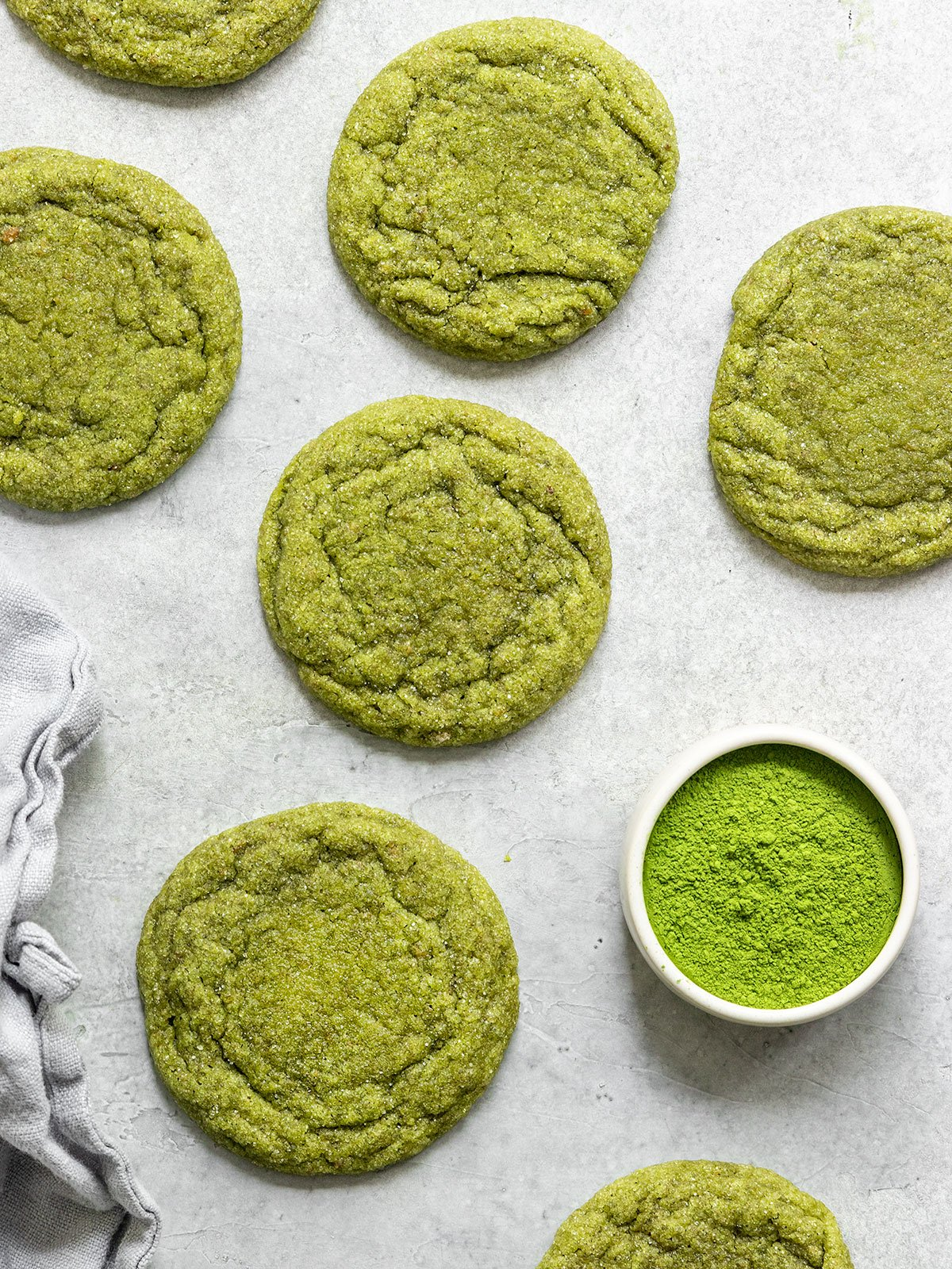 matcha cookies with a cup of matcha powder