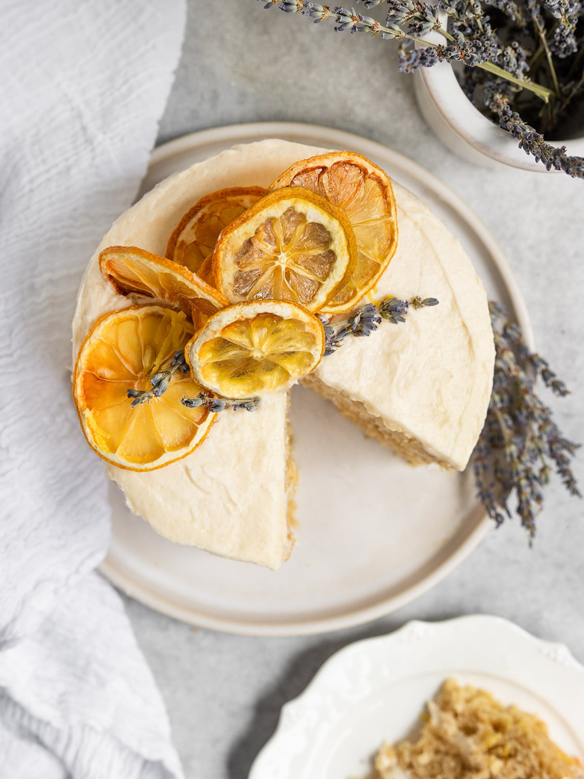 overhead shot of cake with dried lemons and dried lavender and lemon frosting