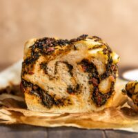 straight on shot showing the inside of a savory spinach tomato babka