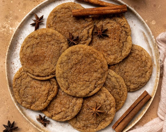 plate of brown sugar cookies surrounded by star anise and cinnamon sticks