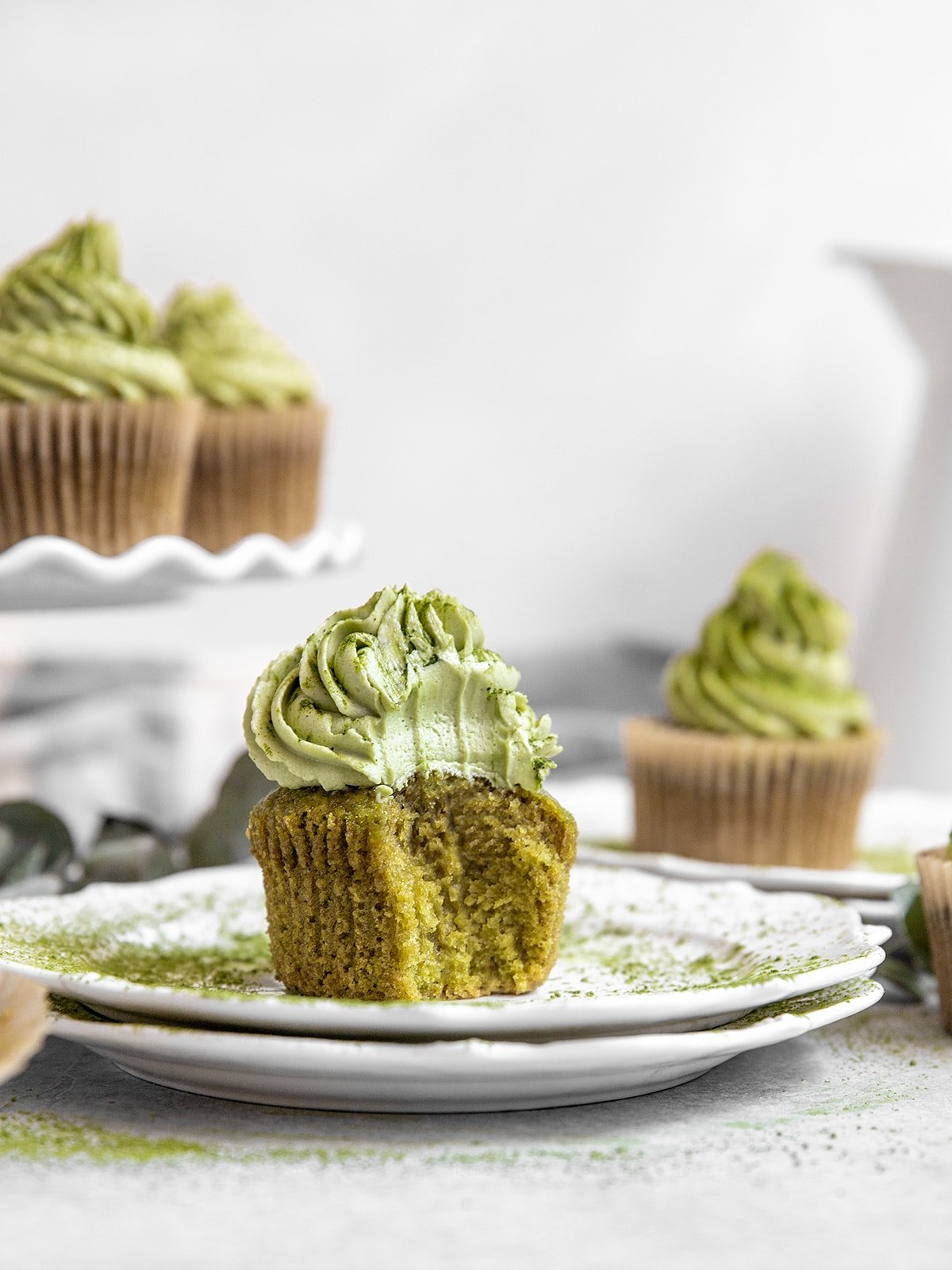 green matcha cupcake with a bite taken out to show texture