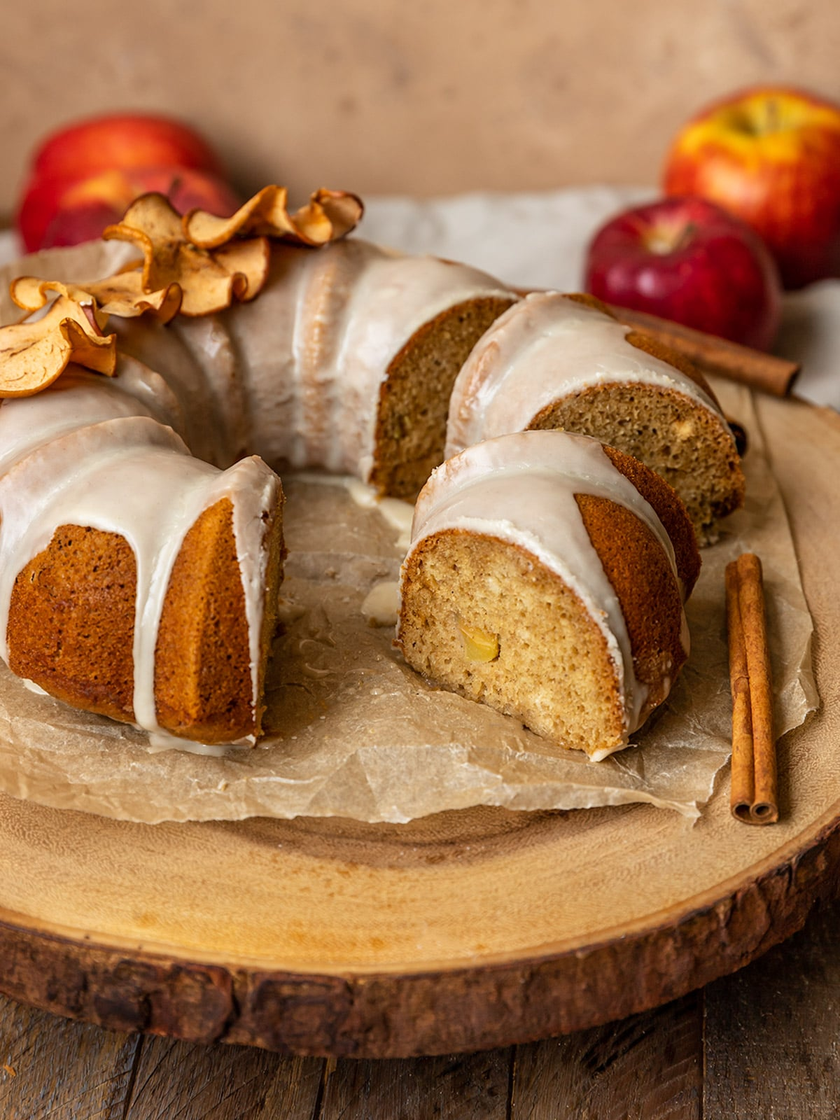 apple bundt cake sliced on a wooden board