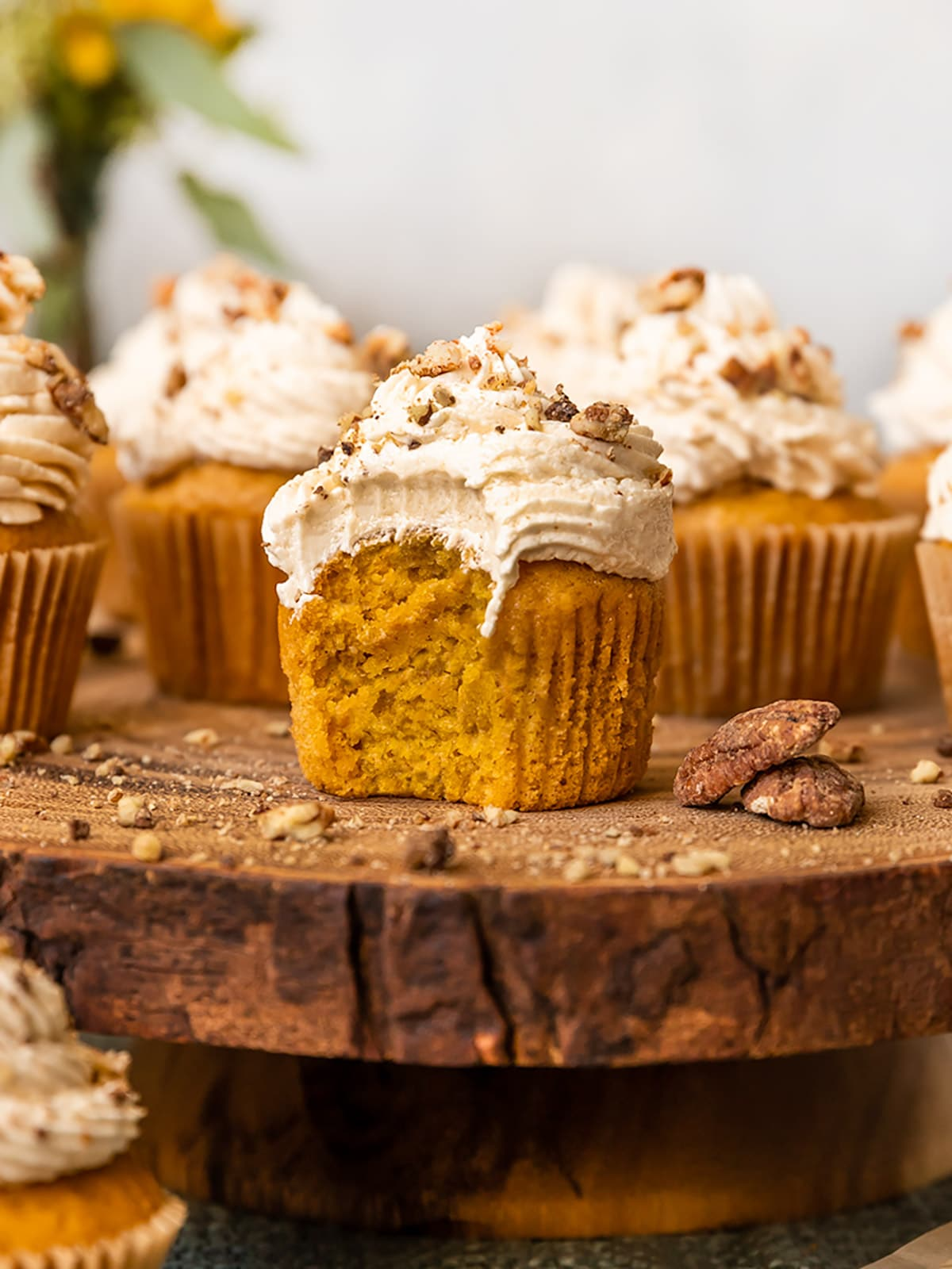 a pumpkin cupcake with a bite taken out to show inside texture