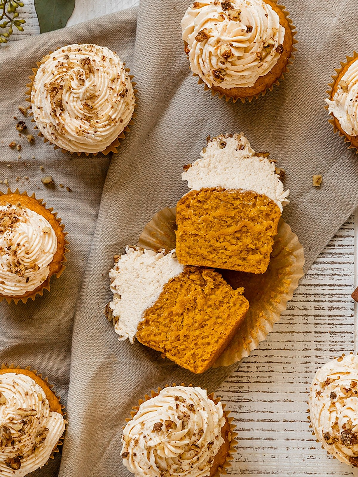 pumpkin cupcake sliced in half to show soft and moist texture inside
