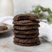 stack of 7 chocolate sugar cookies where the top cookie has a bite taken out of it