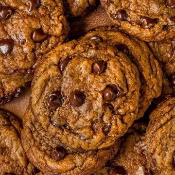 close up overhead shot of pile of pumpkin chocolate chip cookies