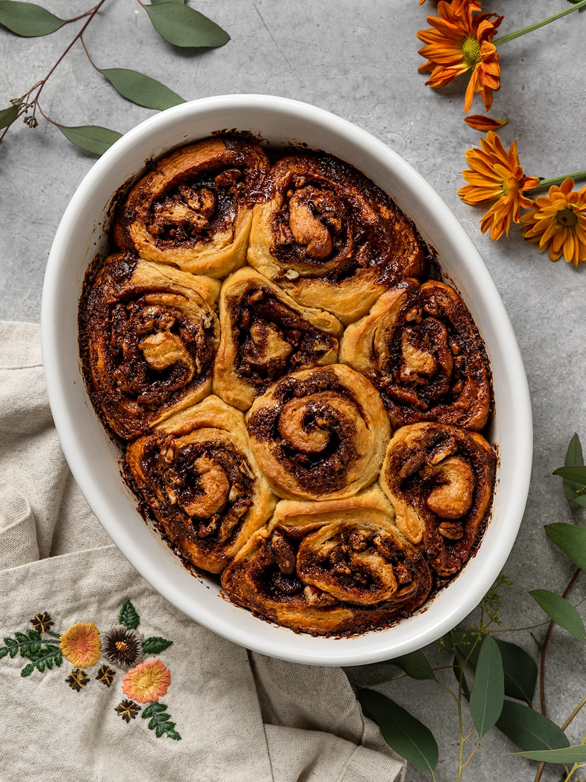 oval pan filled with baked sweet potato cinnamon rolls