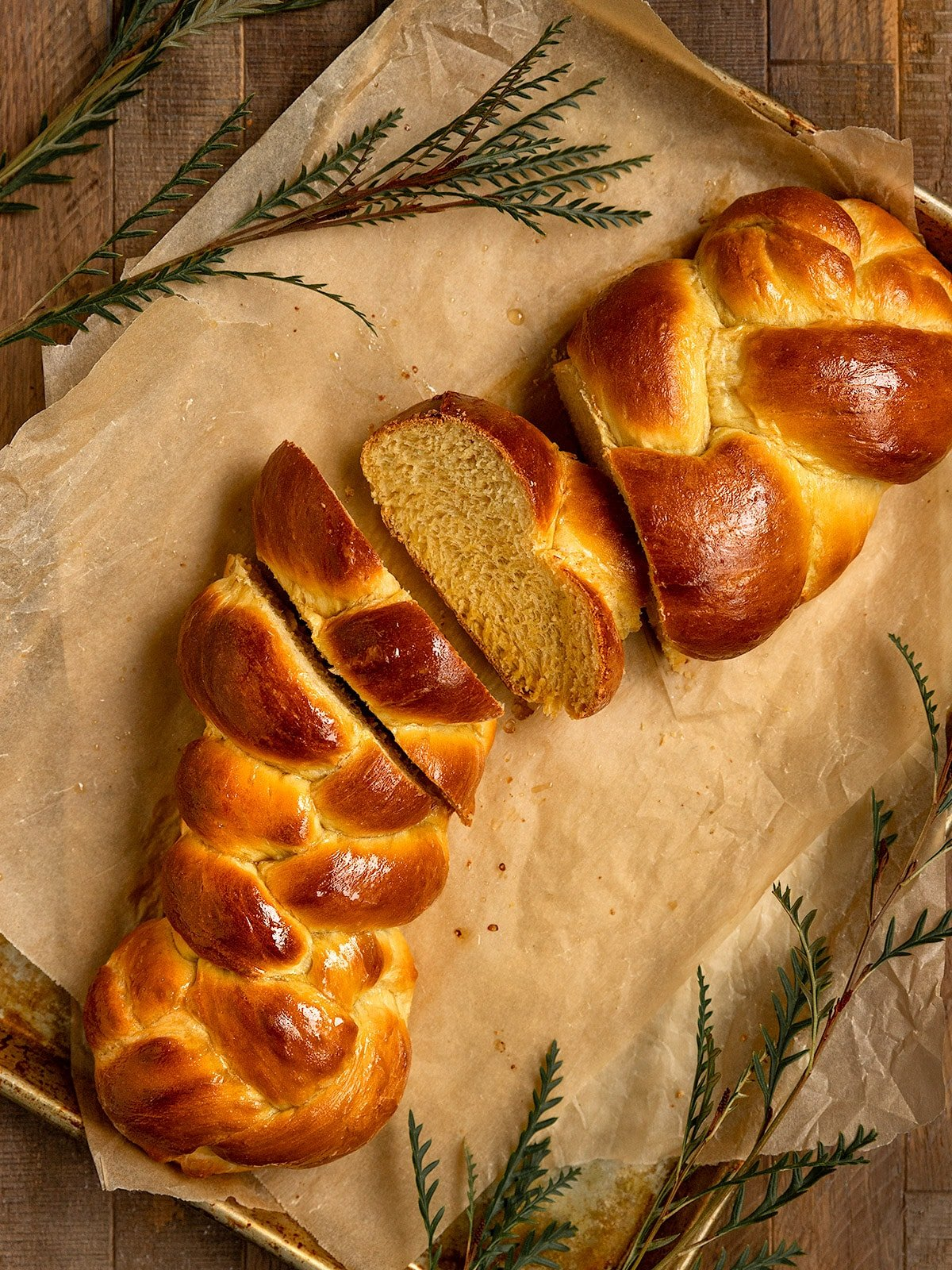 overhead shot of challah with several slices cut