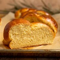 slice of challah standing upright to show the fluffy texture