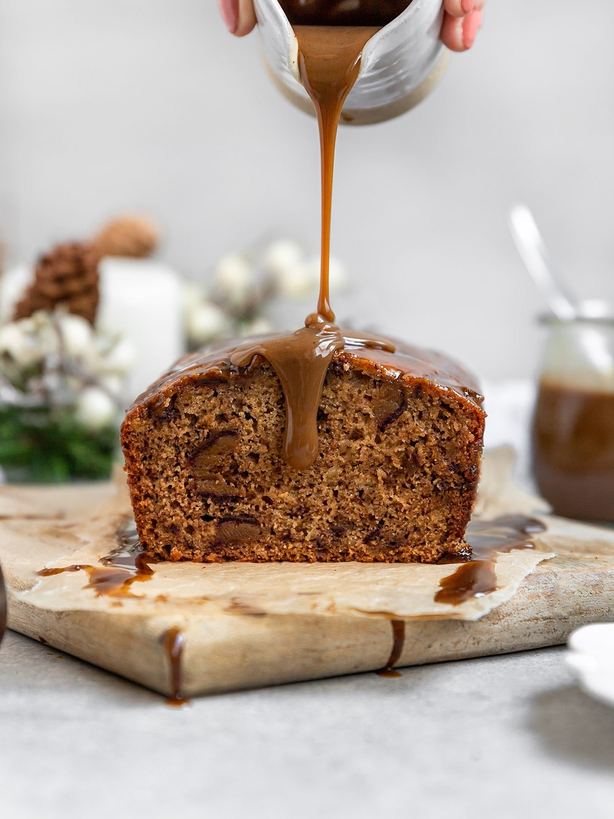 date cake getting drizzled with caramel sauce