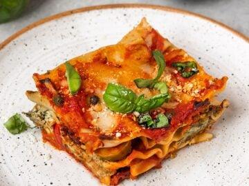 slice of vegan lasagna with tofu ricotta and basil
